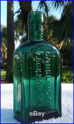 1800's G. W. MERCHANT LOCKPORT N. Y. TOMBSTONE SHAPED ANTIQUE GARGLING OIL BOTTLE