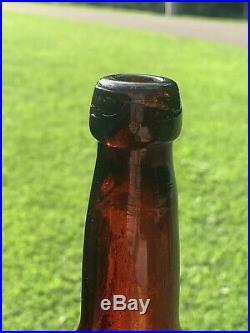 1861-3 Arnold & Co Beer bottle Ogdensburg, NY Amber