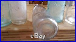 2 antique embossed glass bottles John Nacey Oswego New York pair large & small
