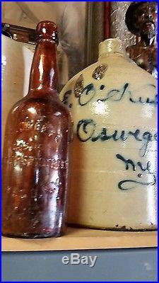 Antique O'Keefe stoneware jug & embossed glass bottle Oswego New York whiskey