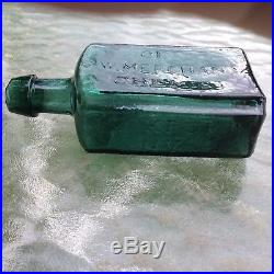 Colored open pontil From The Laboratory Of G. W. Merchant Chemist Lockport NY