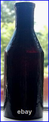 Costar's New York Deep Cherry Puce Open Pontiled Insect Powder Poison Bottle