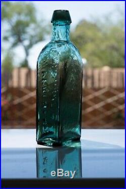 Early Teal G. W. MERCHANT LOCKPORT. N. Y. Civil War Era Bottle