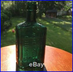 G. W. Merchant, Lockport N. Y. Lockport Tale Green Medicine Bottle