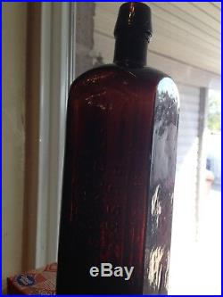 Gorgeous Puce Colored Russ St. Domingo Bitters Bottle, New York, Repaired, crack