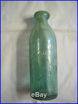 ISAAC A MORAN BRO N. Y. Matthews Gravitating Glass Stopper bottle
