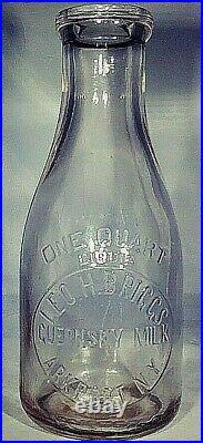Leo H. Briggs GuerLeo H. Briggs Guernsey Milk Bottle Quart Arkport, New York