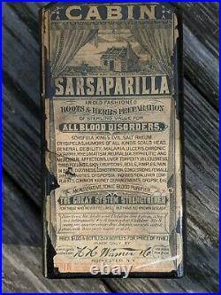 Log Cabin Sarsaparilla Rochester, N. Y. Dark Amber. Bold Embossing LABEL