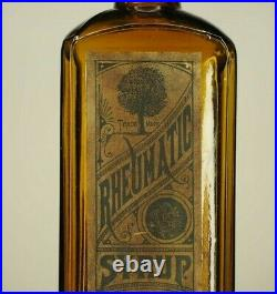 Rheumatic syrup 1882, Rochester N. Y. Bottle with embossed tree, full front label